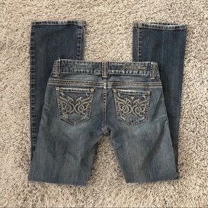 GUESS Distressed and Ripped Stitch Bootcut Jeans